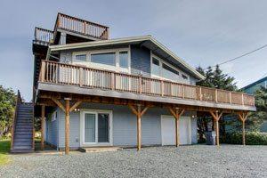 Big blue house with wraparound balcony