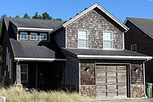 Two-story house with small garage for rent