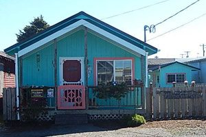 Blue house with pink trim