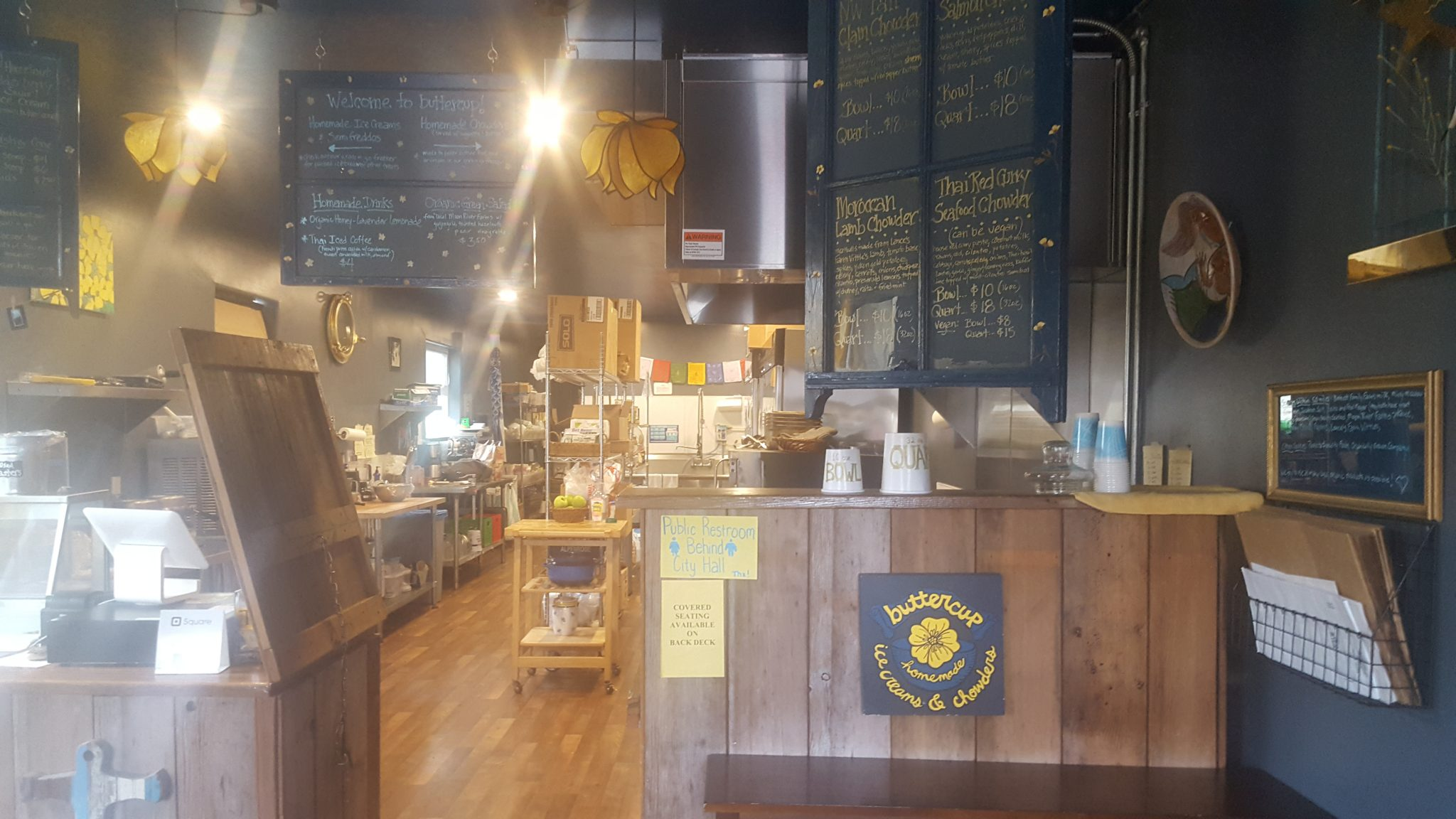 Inside of the Buttercup shop—counter for ordering with menus written on chalkboards overhead
